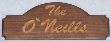 oak and walnut family name sign